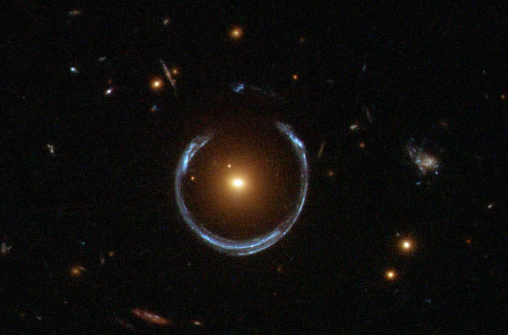 Another Einstein ring.  This one is called LRG 3-757.  This was detected by a Sloan Digital Sky survey, but this image was captured by Hubble's Wide Field Camera 3. Photo: NASA / Hubble / ESA