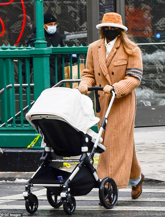 New mom: Late last year, Gigi gave birth to a baby girl with her partner Zayn Malik;  He was seen last month in New York City with the baby