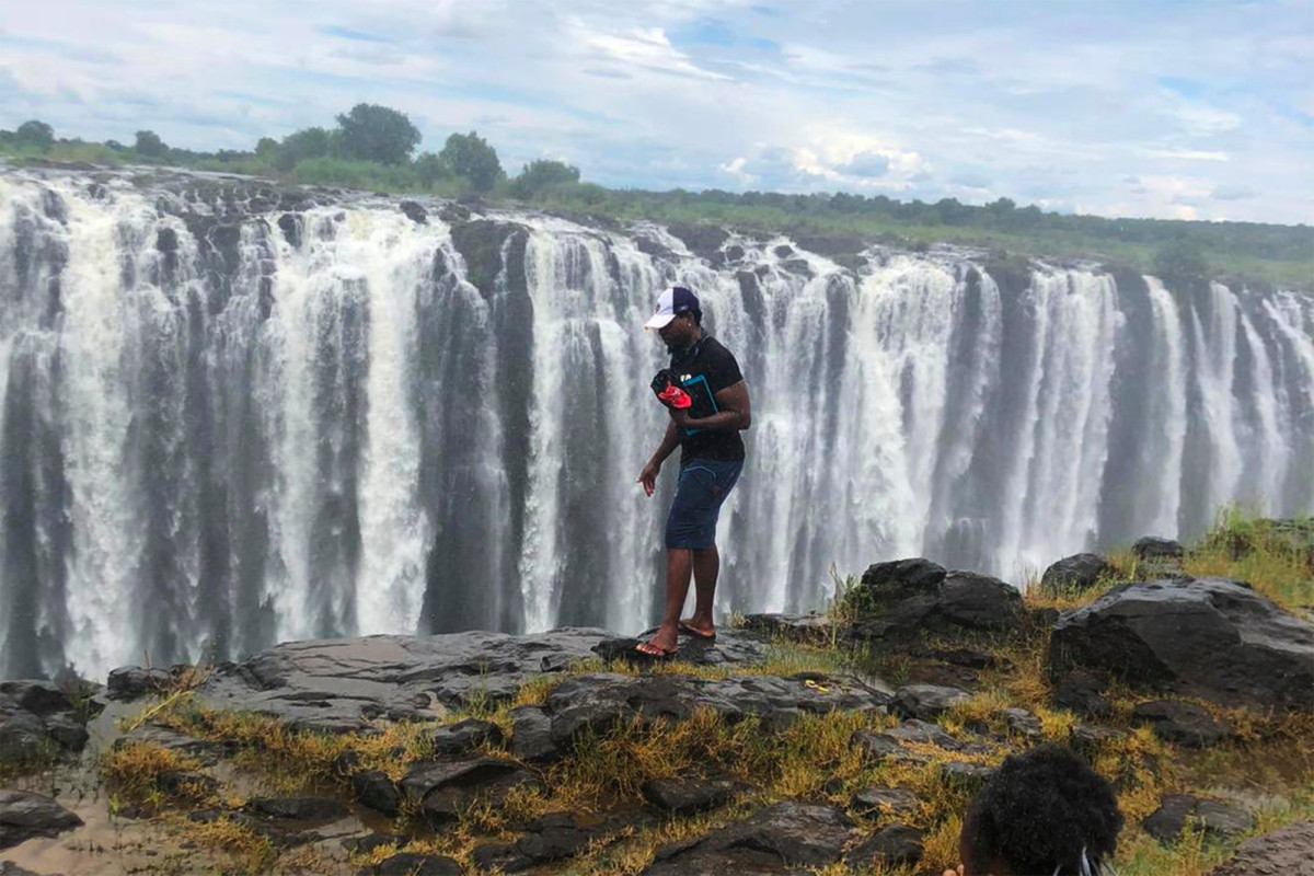A man pictured at the edge of Victoria Falls before he fell to his death