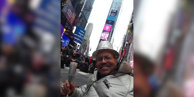 Ronald Colbert celebrates New Year's Eve in Times Square in Manhattan on December 31, 2019. As a longtime celebrant, he's hoping to return to the field to watch the ball drop for the last time.